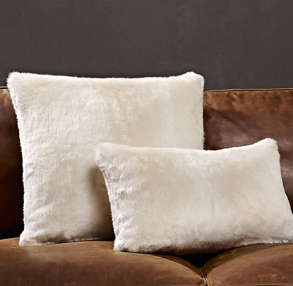 These faux fur pillows add definite texture. In everything but the paint, you can use creamier whites. I encourage mixing shades of white! Restoration Hardware Luxe Faux Fur in Arctic White, $29-$49