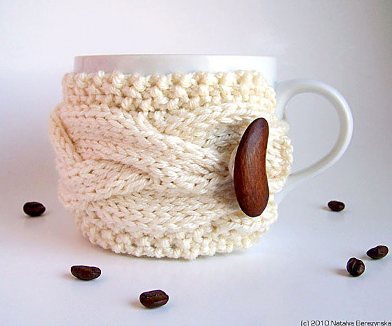 Adorable cable knit cup cozy in white. On Etsy for  $17.50.