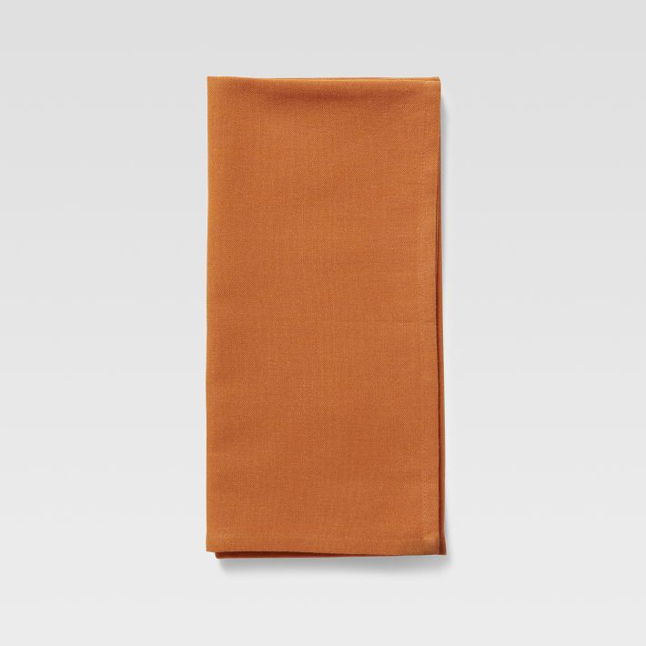 I often keep my kitchen table set, even if I'm not expecting company. I have these napkins on top of of grasscloth place mats. Tangerine Cross Dye Napkin, West Elm, $9.99.