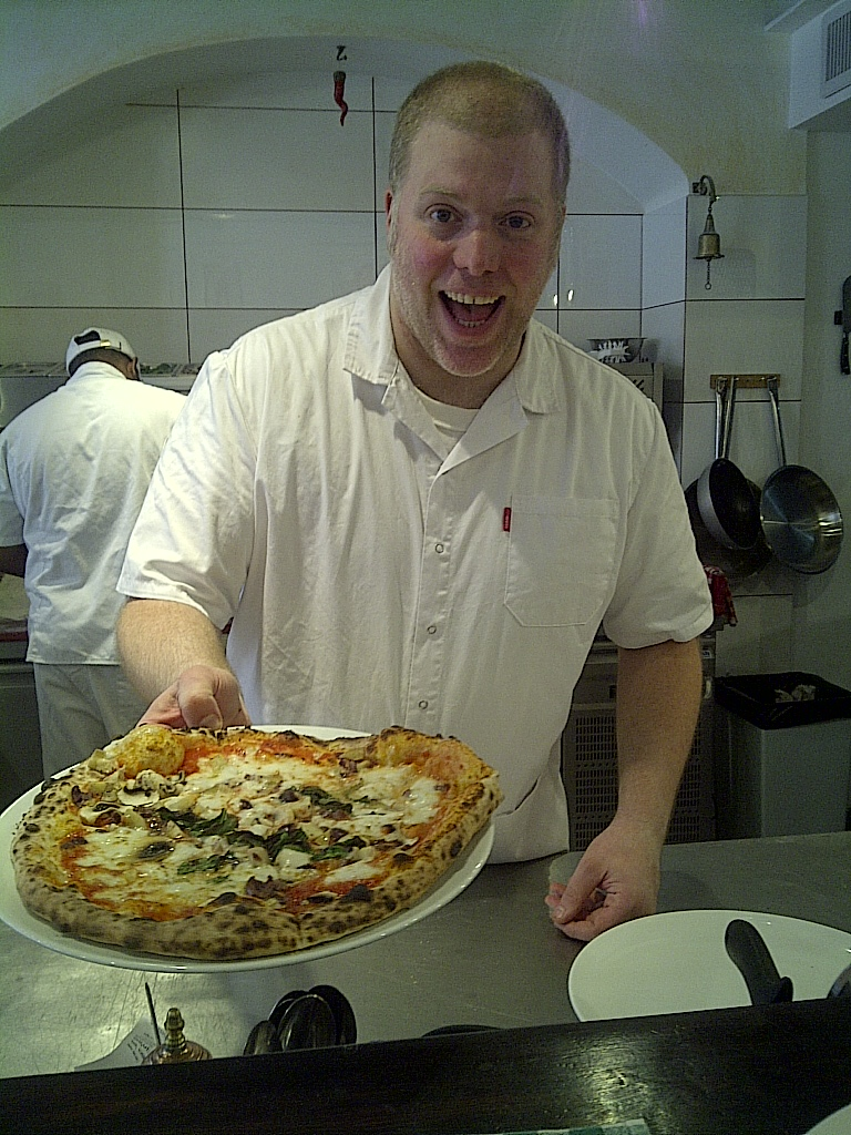 Giuseppe (Peppe) serves up his favorite pizza pie