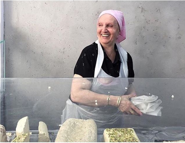 Linda serving up some of her cant-be-beat halva.