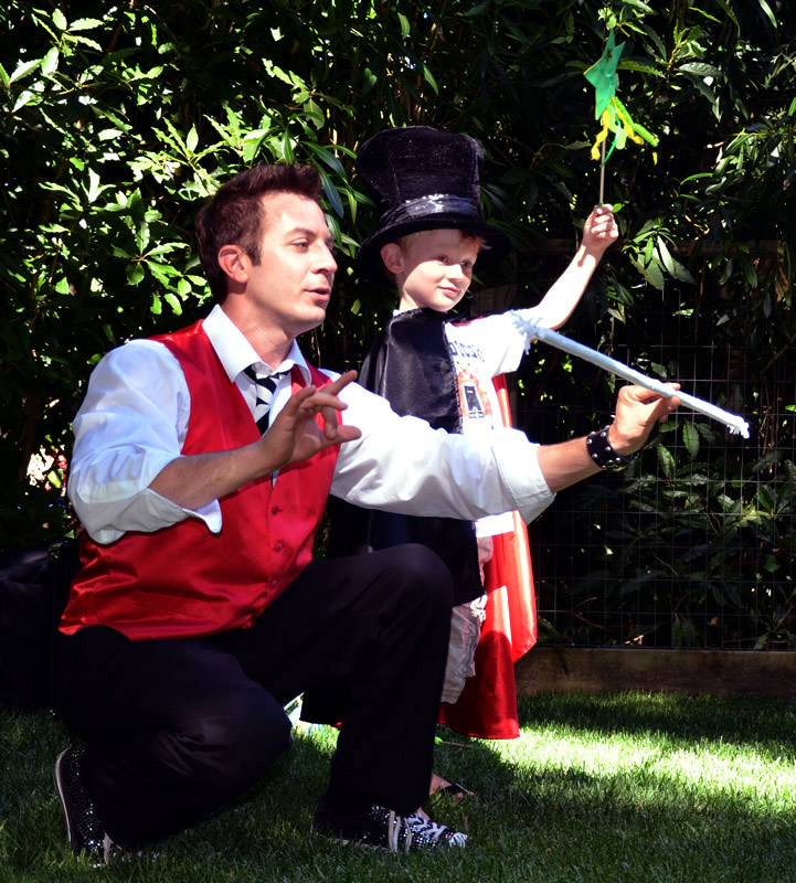 A young boy becomes the magician.