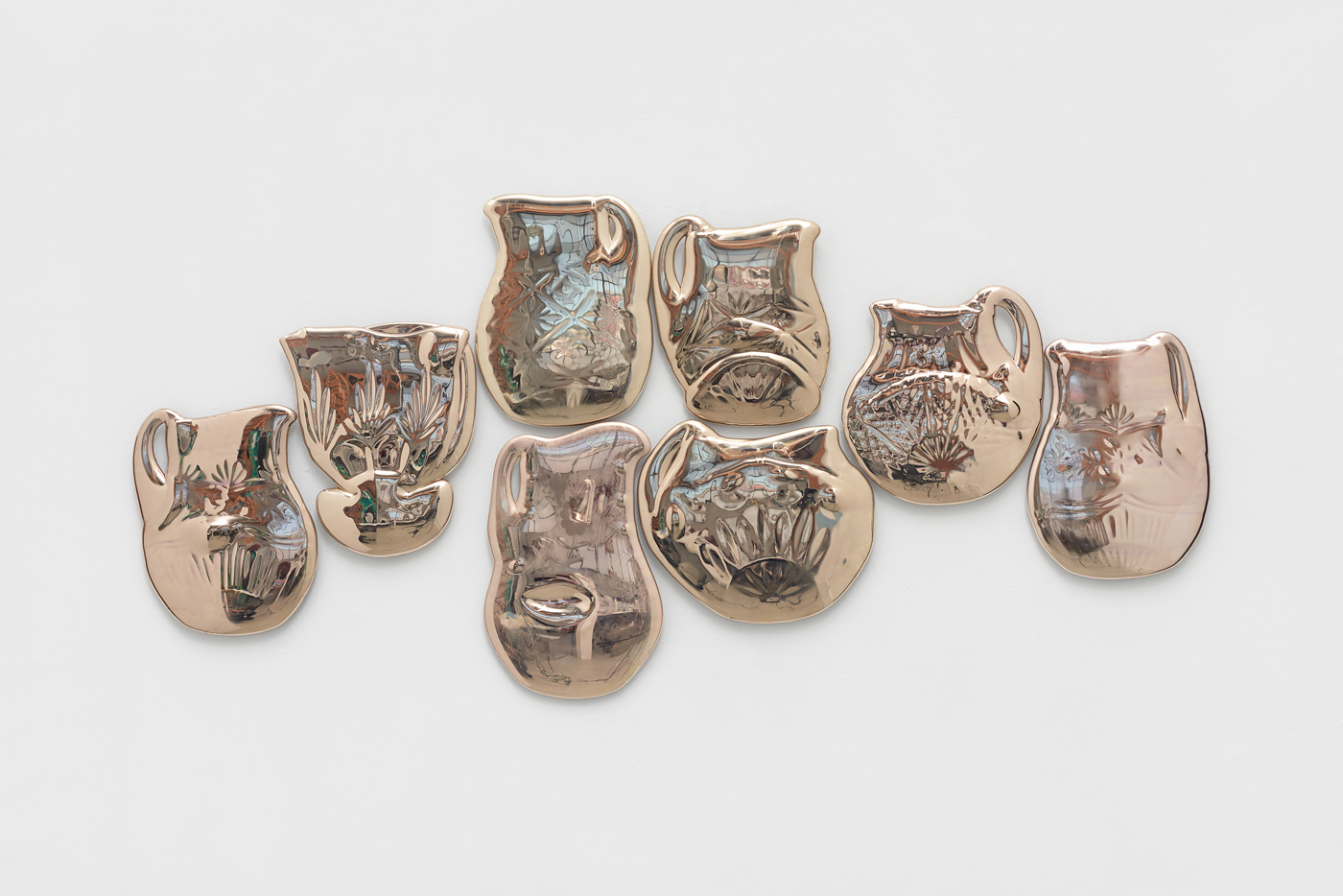 Amassment,  8 melted lead crystal pitchers coated with silver nitrate. 2017. Photo credit: John Janca