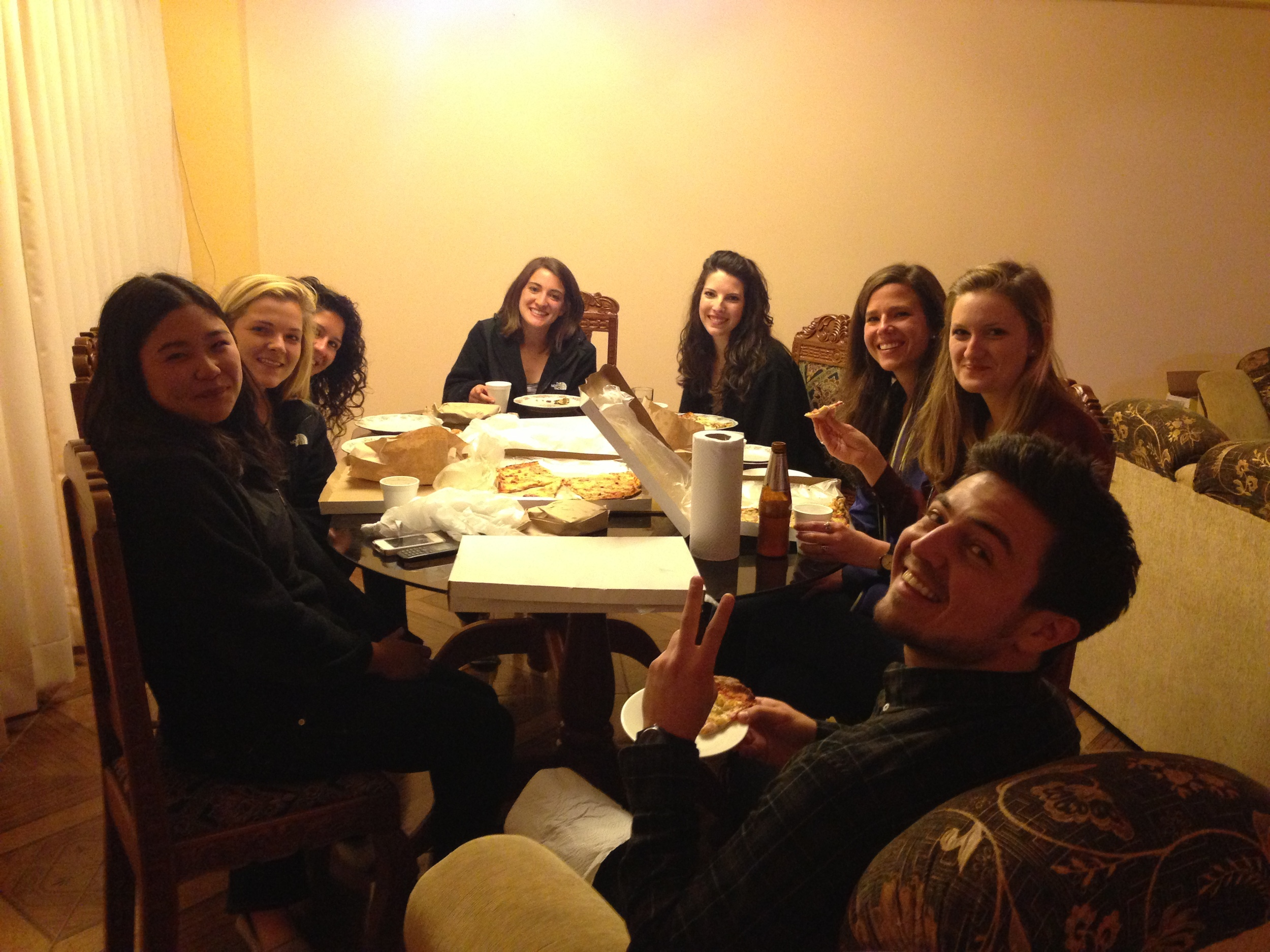"""Our team dinner celebration of a very successful first day of enrollment! The interns thoughtfully brought a tasty chocolate cake that said, """"Alma Sana, Si se puede"""". Photo taken: June 1, 2013."""