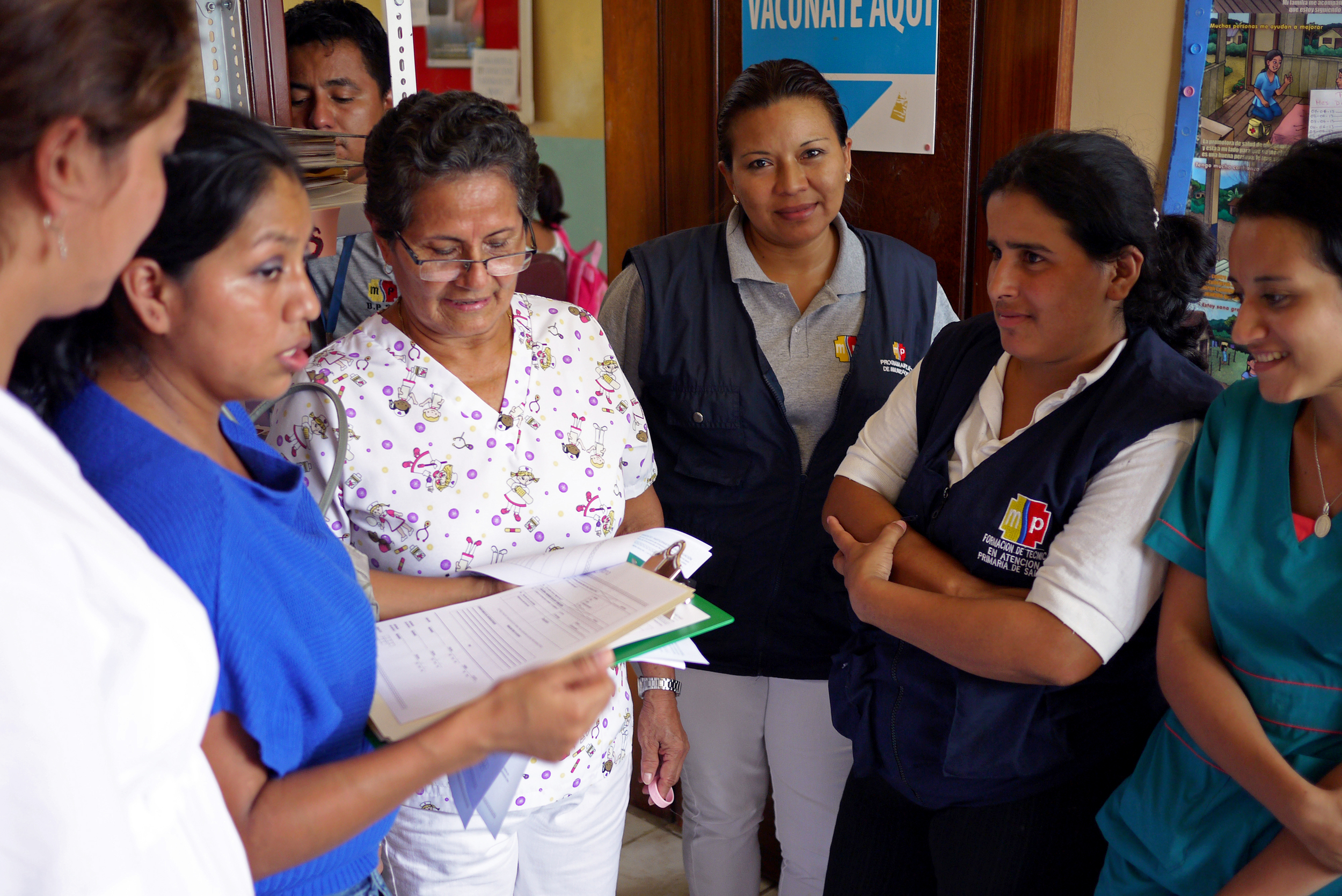 Guadalupe (in blue), a vaccine expert with the Ministry of Public Health in Ecuador, trains the nurses on how to track data on our forms. Photo taken: June 25, 2013.