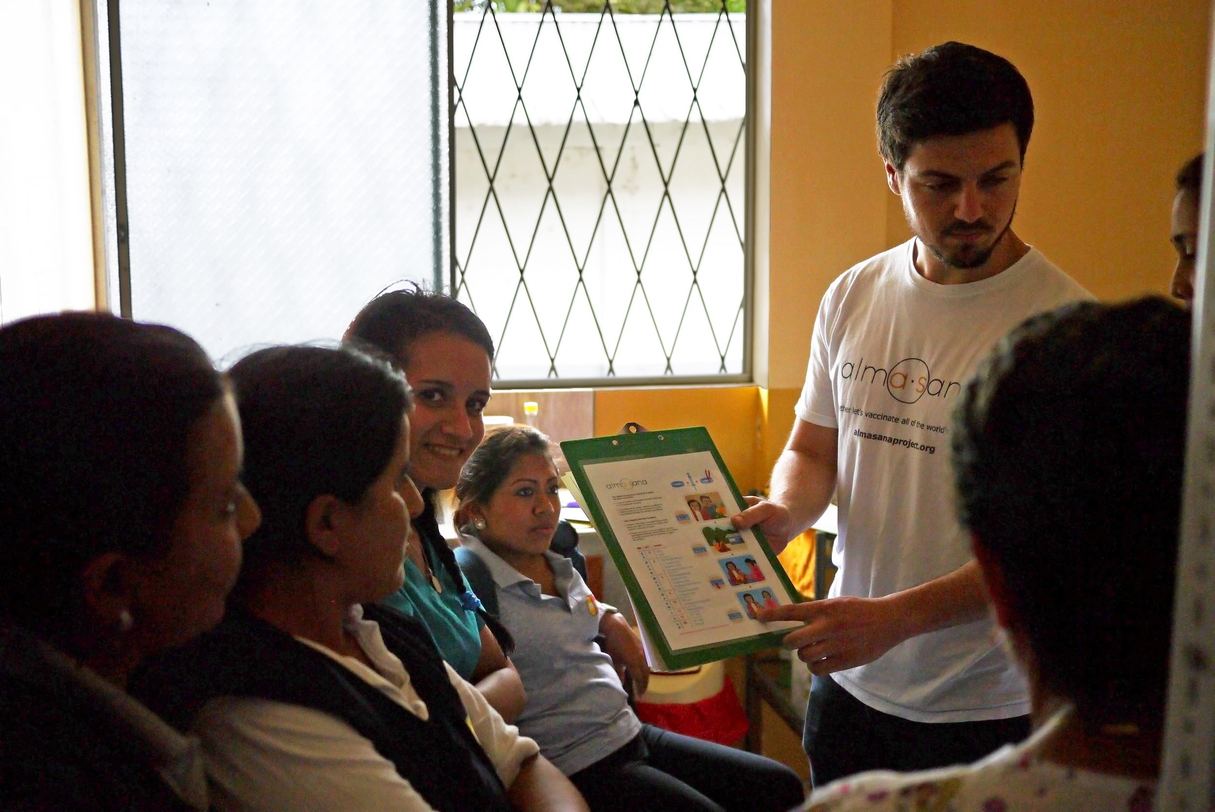 Alex Bozzette, our Ecuador Project Coordinator, trains the Ministry of Public Health nurses on how the bracelets work and how to explain them to moms using a bracelet vaccination guide (shown). Photo taken: June 25, 2013.