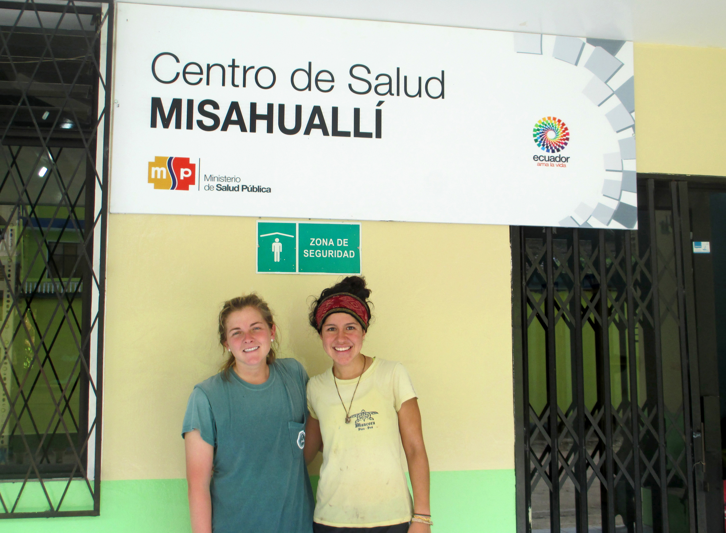Two of our Cusco summer interns, Vanessa Riva and Amy Scheel, visited our project site in rural Tena, Ecuador. Here they're standing in front of Misahualli, one of the four clinics we're working in. Photo taken: July 16, 2013.