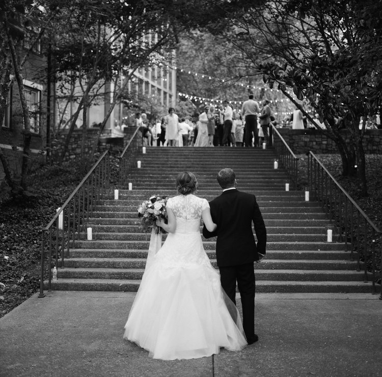 Lily & Jeff the moment before they greet their family and friends for the first time as a married couple. The wedding took place at Cheekwood Botanical Garden in Nashville, TN, and was planned and designed by B