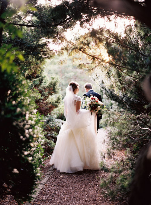 Lily and Jeff explore the gardens at Cheekwood Botanical Gardens moments after becoming husband and wife. Wedding planning and design by Big Events Wedding.