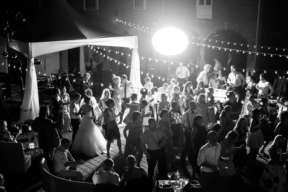 Family and Friends dance the night away at Lily & Jeff's Wedding Reception Dance Party - Cheekwood botanical Gardens in Nashville, TN. Wedding planning and design by Big Events Wedding.