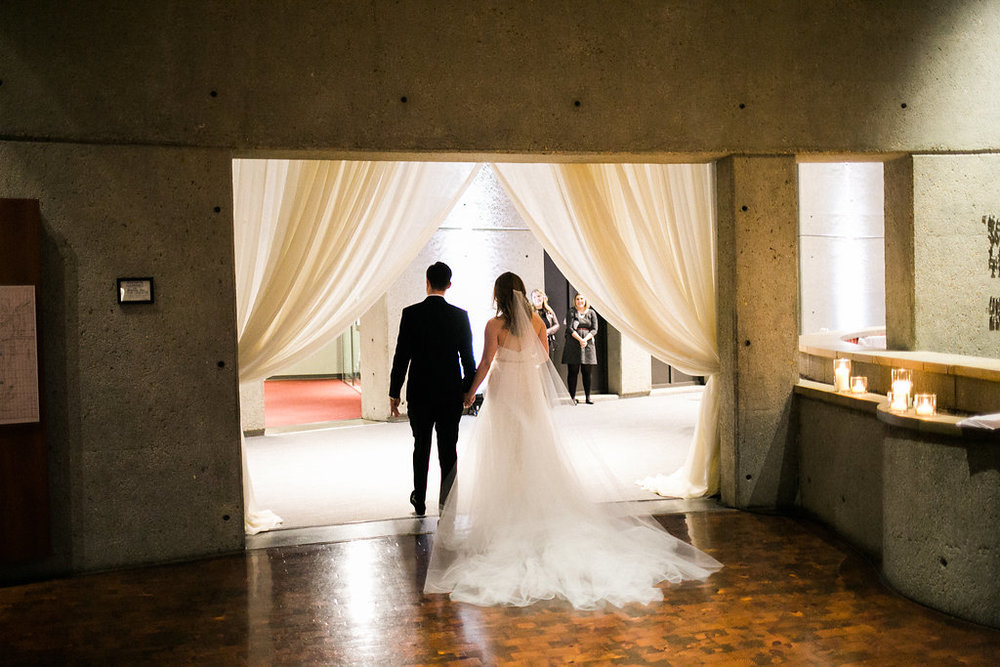 The Horne couple get ready to greet their loved ones moments after getting married at the Country Music Hall of Fame. Wedding planning & design by Big Events Wedding.