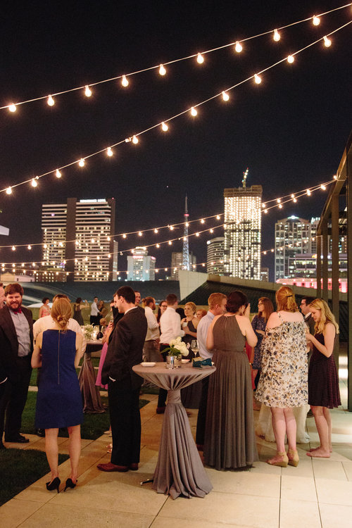 Guests enjoy the view of downtown Nashville at this Country Music Hall of Fame wedding reception. Wedding planning & design by Big Events Wedding.