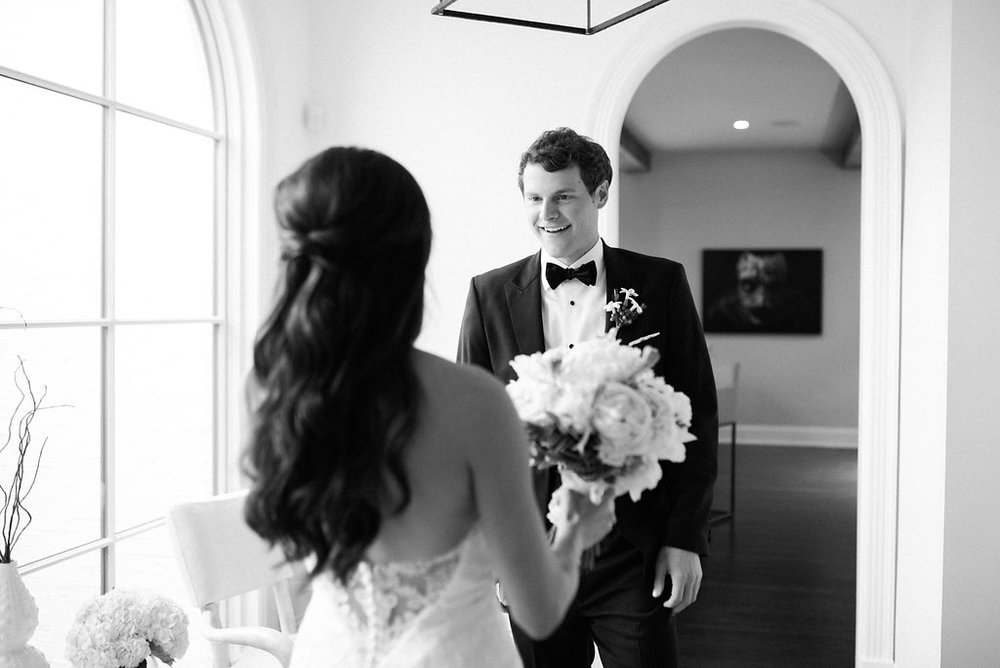 The groom sees his stunning bride at the Frist Center for the Visual Arts in Nashville, TN. Wedding planning & design by Big Events Wedding.