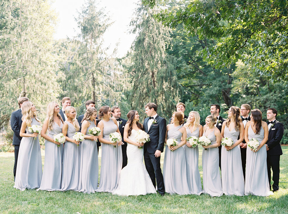The Bride & Groom with their bridesmaids and groomsmen just before their wedding at the Frist Center for the Visual Arts in Nashville, TN. Wedding planning & design by Big Events Wedding.