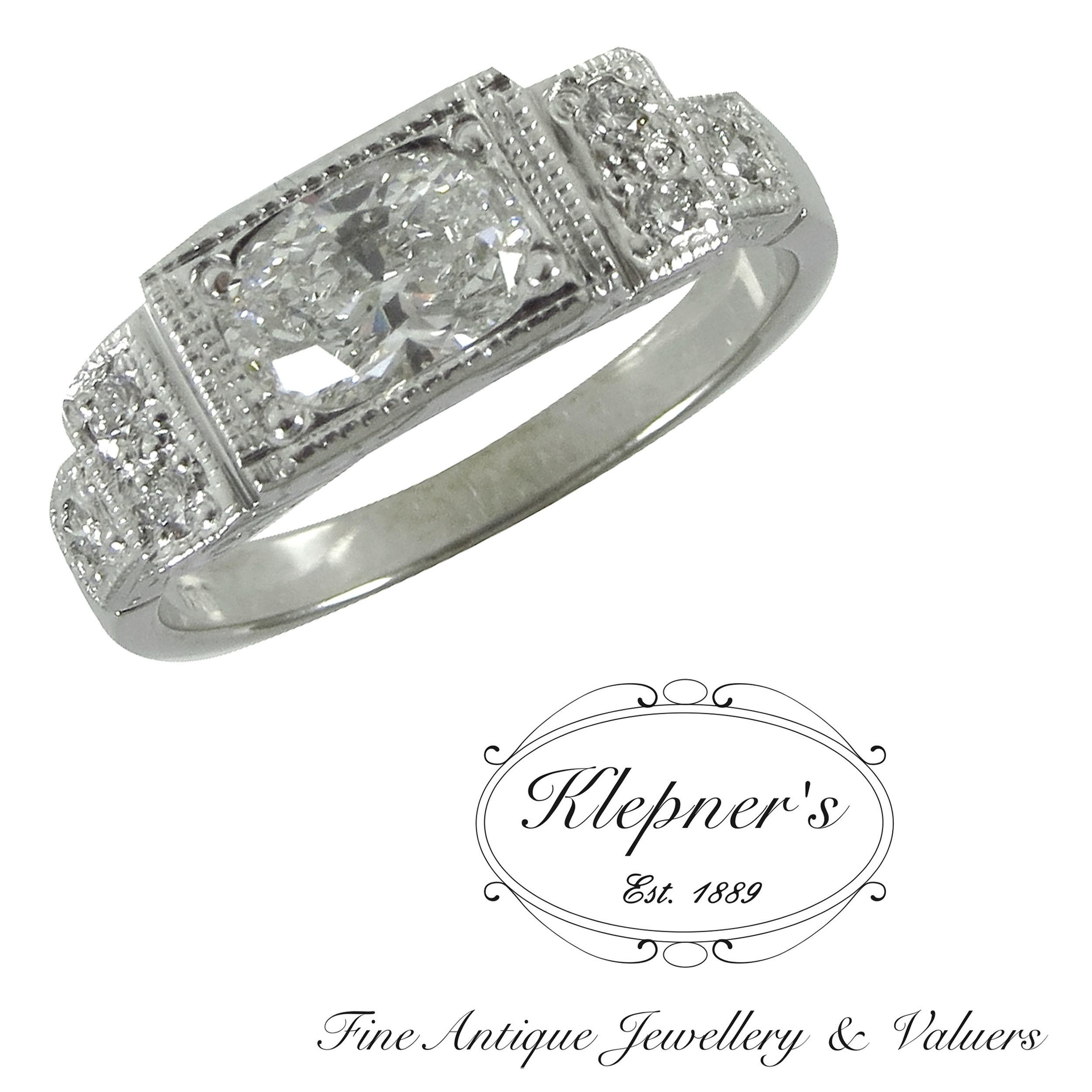 Art Deco inspired 18ct white gold diamond engagement ring.