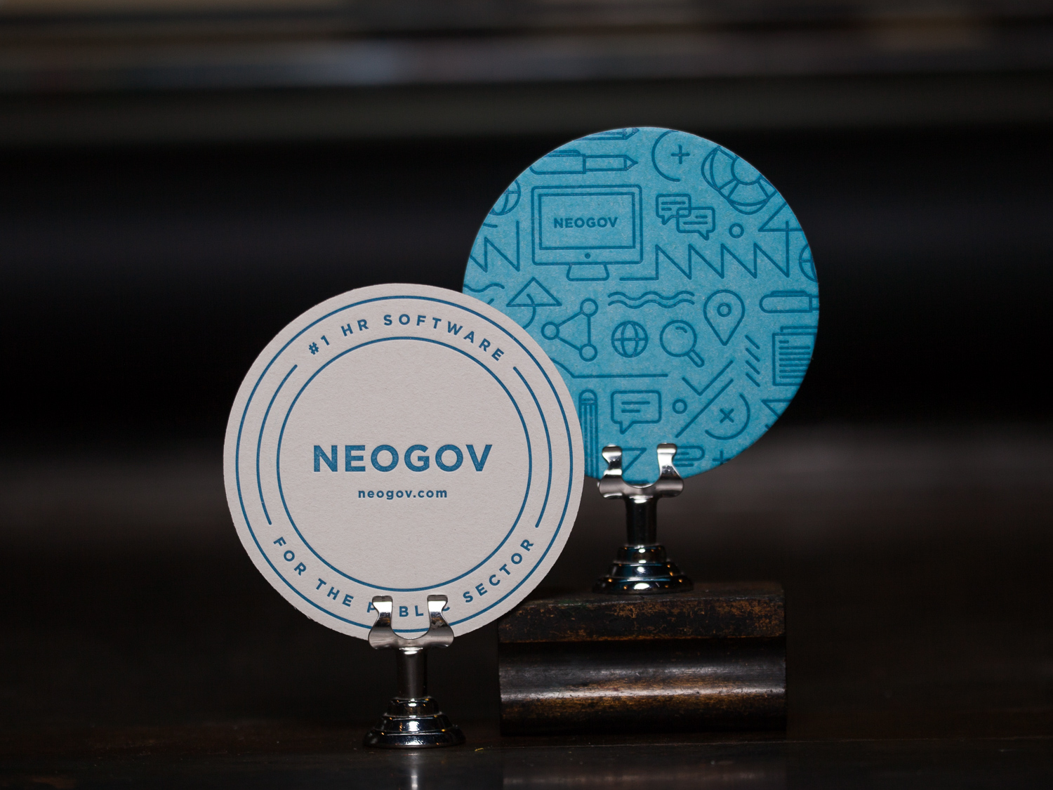Customer:   NEOGOV   Artwork by:   NEOGOV   Paper Stock:  80pt. coaster stock  Process:  2C Letterpress / 1C Letterpress  Press:  Chandler & Price