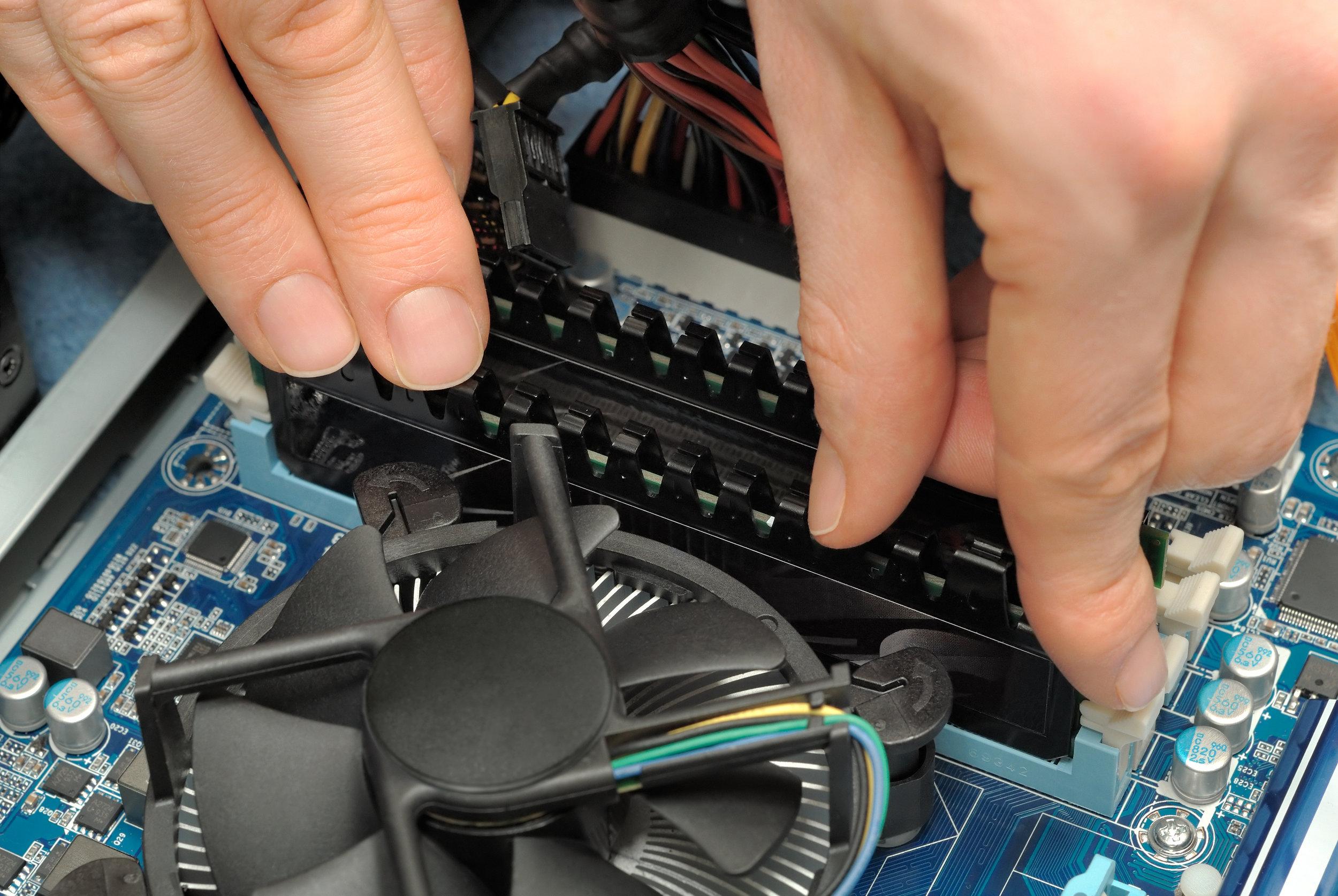 bigstock-Hands-Installing-Computer-Part-7968816.jpg