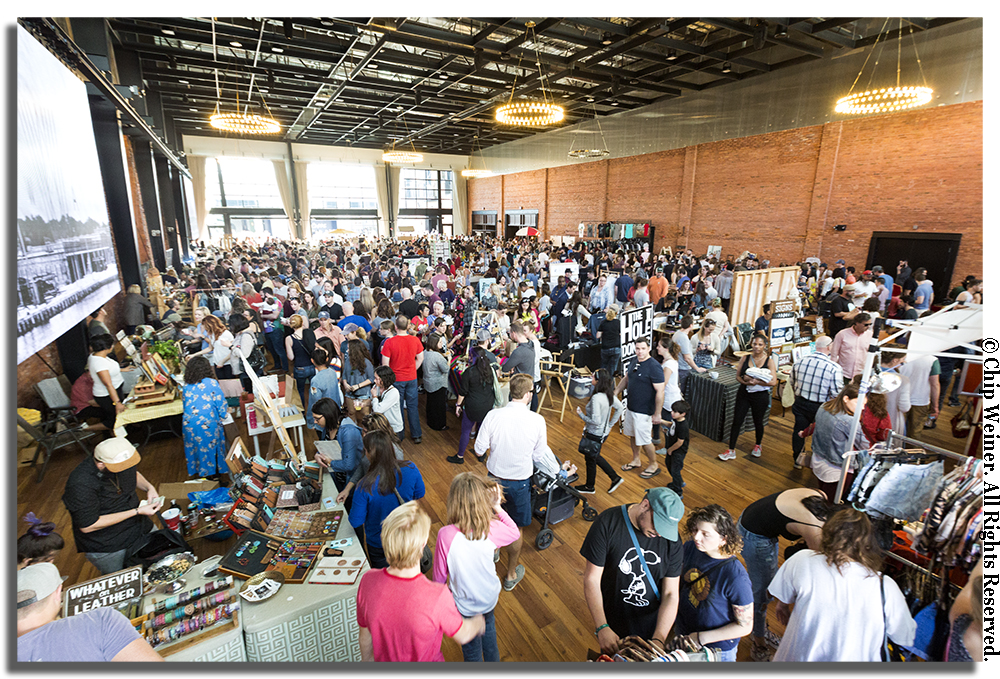 Hundreds of people filled the new space at Armature Works to peruse the wares of local vendors