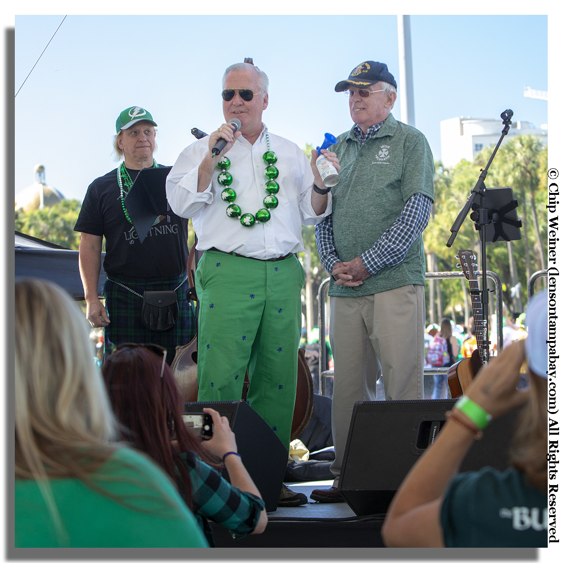 Before starting the event with his trusty air horn, Mayor Bob Buckhorn Honors an veteran during the River O'Green.