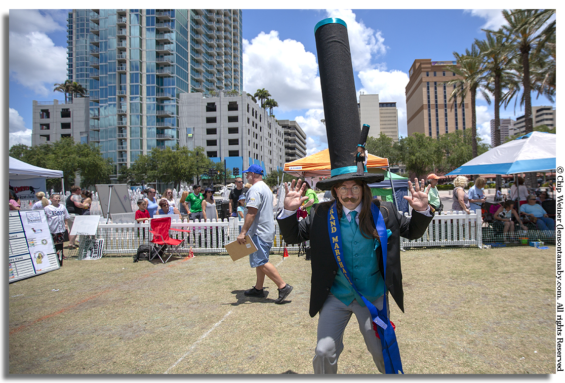 Odilon Ozare who just set the Guinness world record for the world's tallest hat (not pictured), was the Grand Marshall judge for the Wiener Dog costume contest