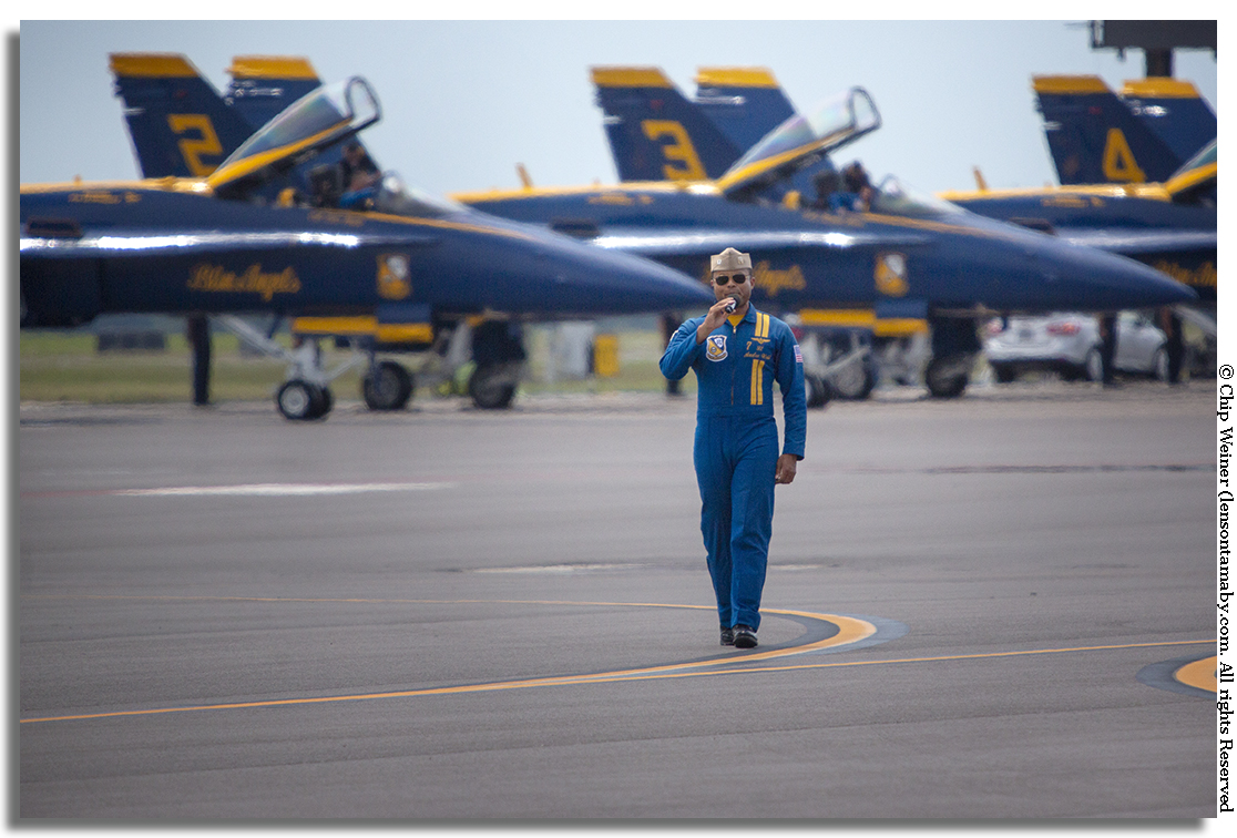 Navy Lt. Andre Webb, pilot number 7, announces for the Blue Angels