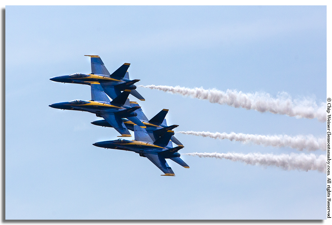 The Blue Angels are the darlings of the airshow with good reason. Their precision flying is amazing! Those are F-18 fighter jets within feet of each other!