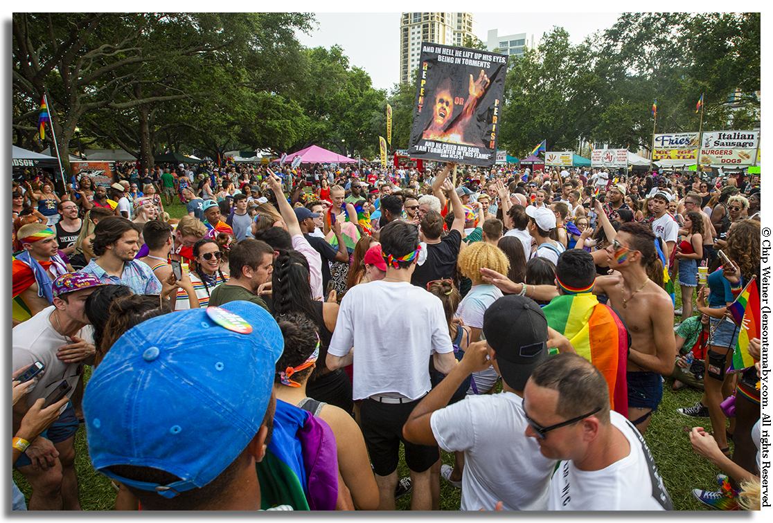 In North Straub Park in St Petersburg people attending Pride react to a sign condemning to hell those who do not repent