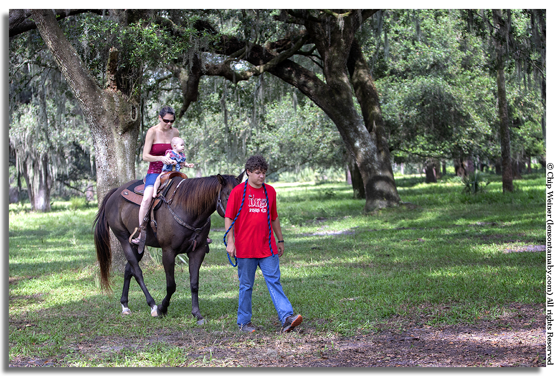Horses of all sizes are ready for a guided ride. This mom and her soon-to-be cowgirl try it out