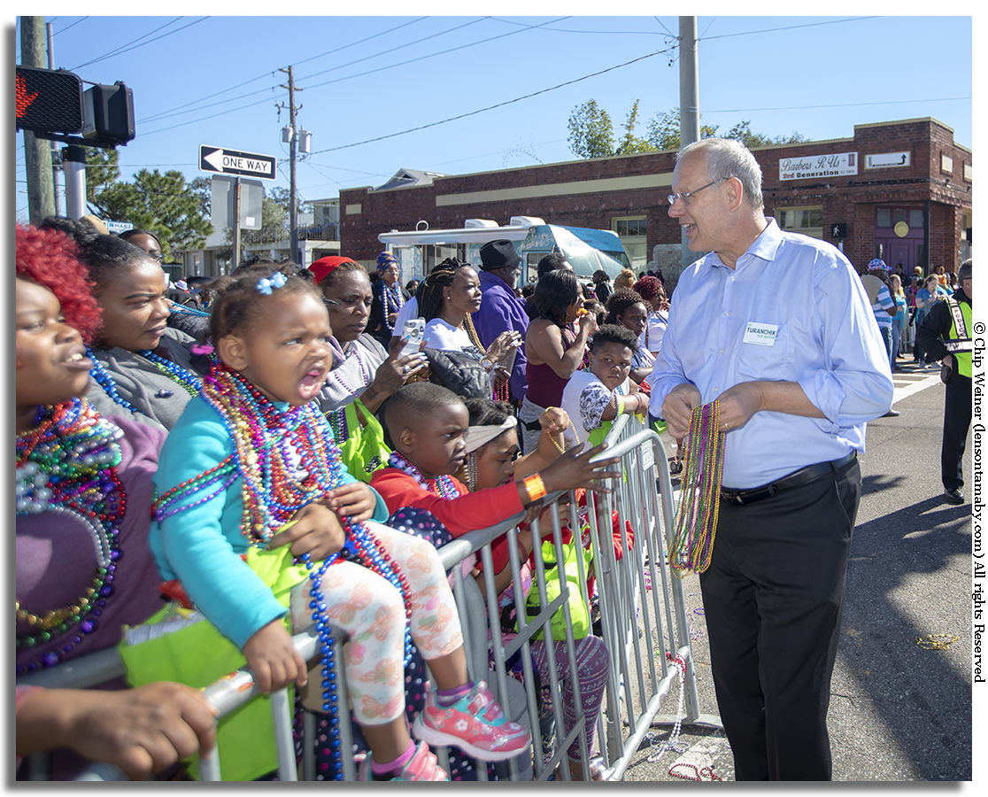 Ed Turanchik works the crowd of potential and future voters as a candidate for mayor