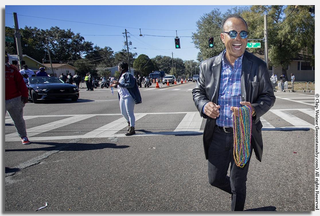 Reginald Roundtree, WTSP news anchor, smiling big at the Tampa MLK parade
