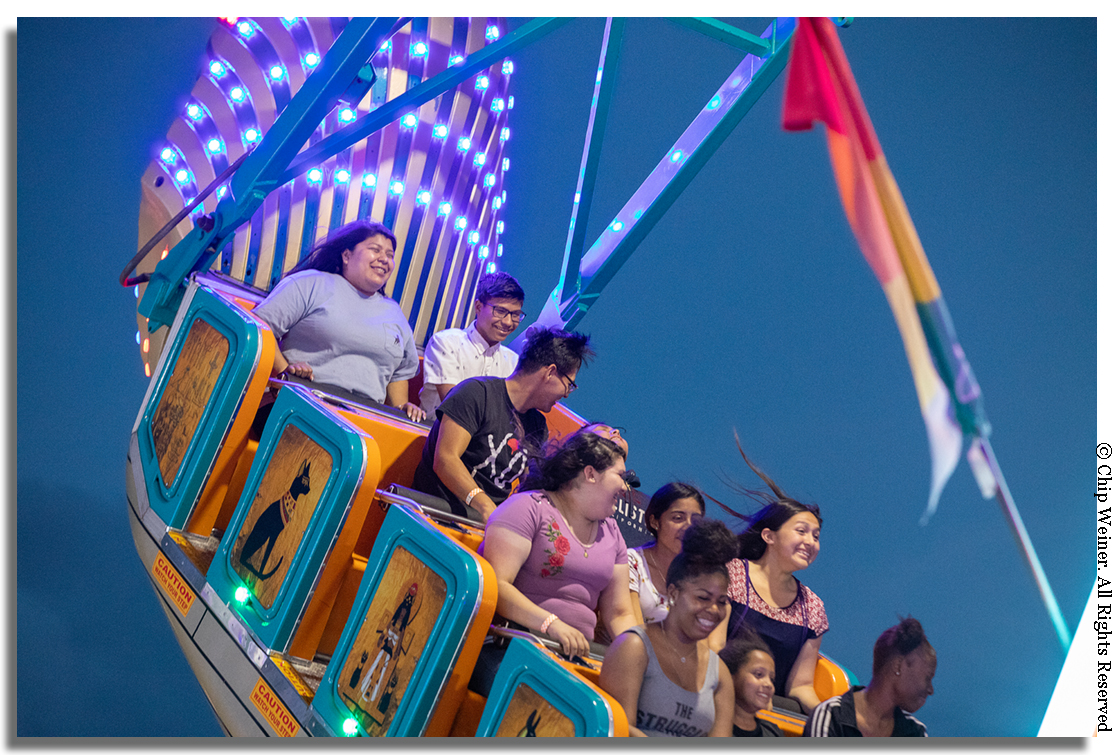 The Midway is filled with the screaming voices of carnival ride riders having their hair and stomachs turned while being flipped, inverted, and thrilled.