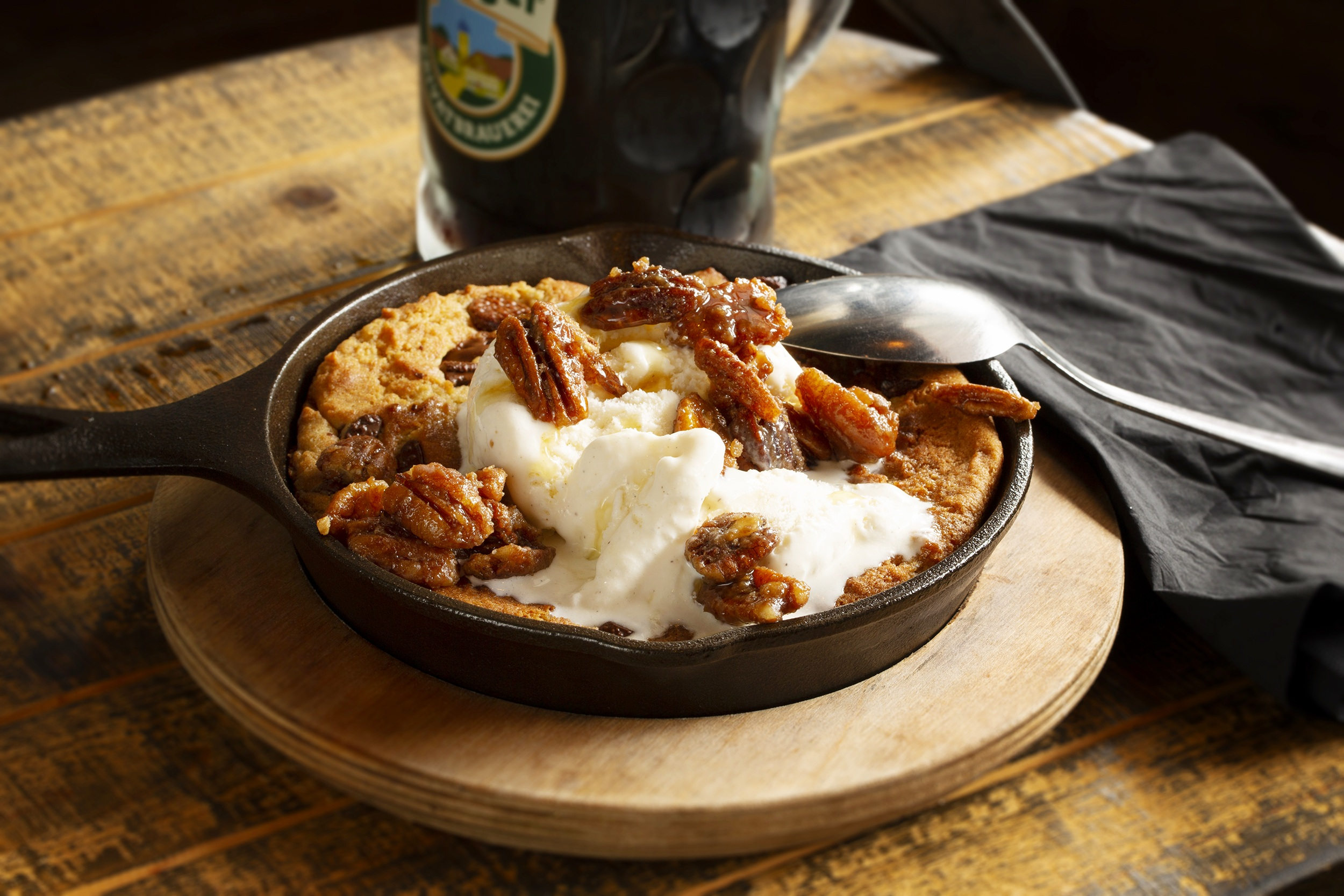 Prost+Kitchen+Cast+Iron+Cookie-Baked+to+order+chocolate+chip+cookie+skillet+topped+with+vanilla+ice+cream%2C+candied+pecans+and+honey+1.jpg