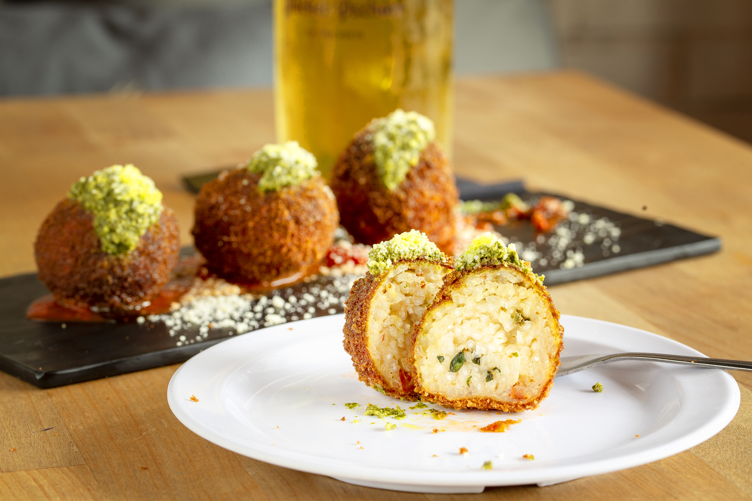 Prost Kitchen Arancini-Crispy balls of Parmesan risotto stuffed with mozzarella and sun dried tomatoes. Served with marinara and basil pesto 1.jpg
