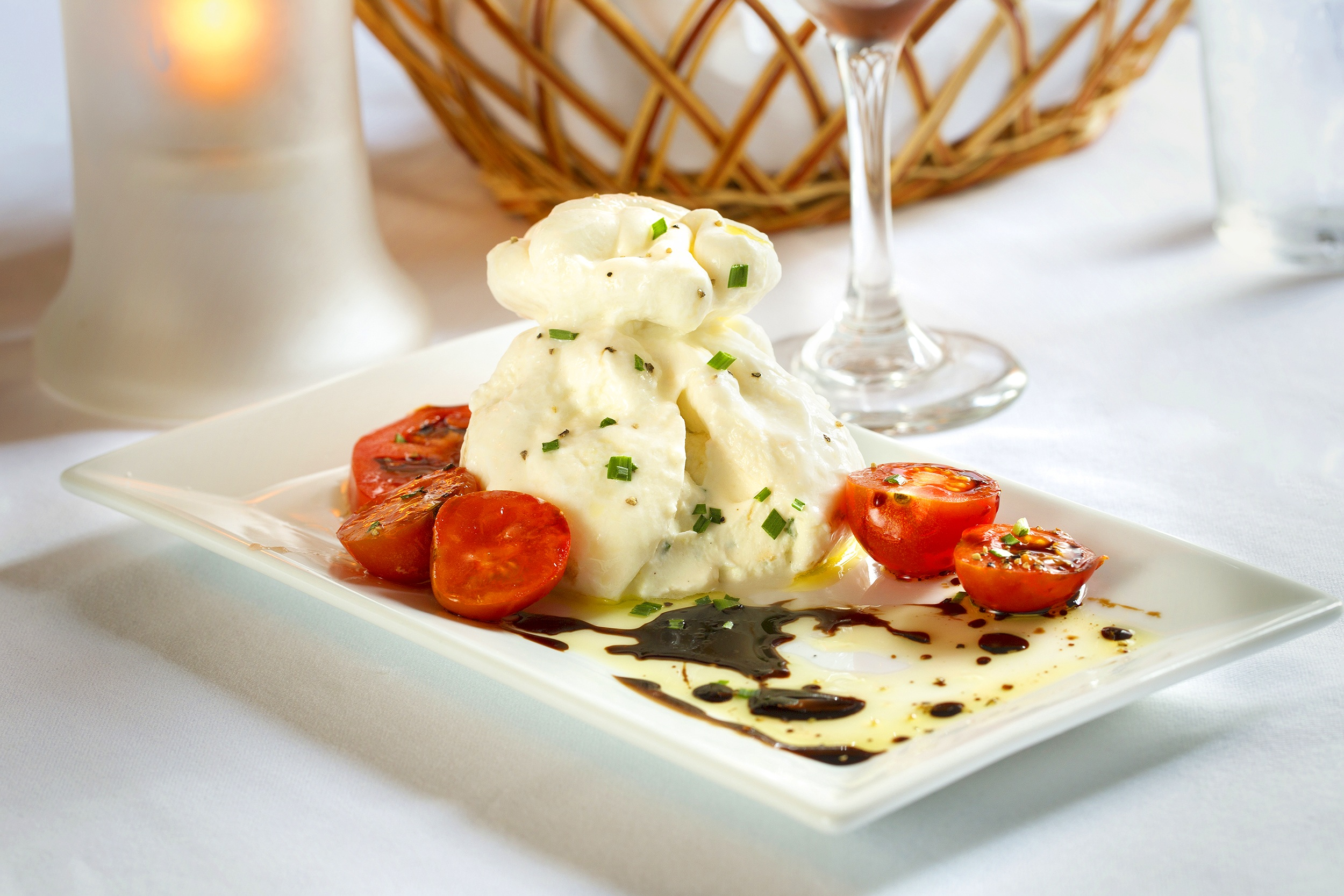 Burrata-+House+made+mozzarella+filled+with+herbed+ricotta+and+served+with+local+heirloom+tomatoes+2.jpg