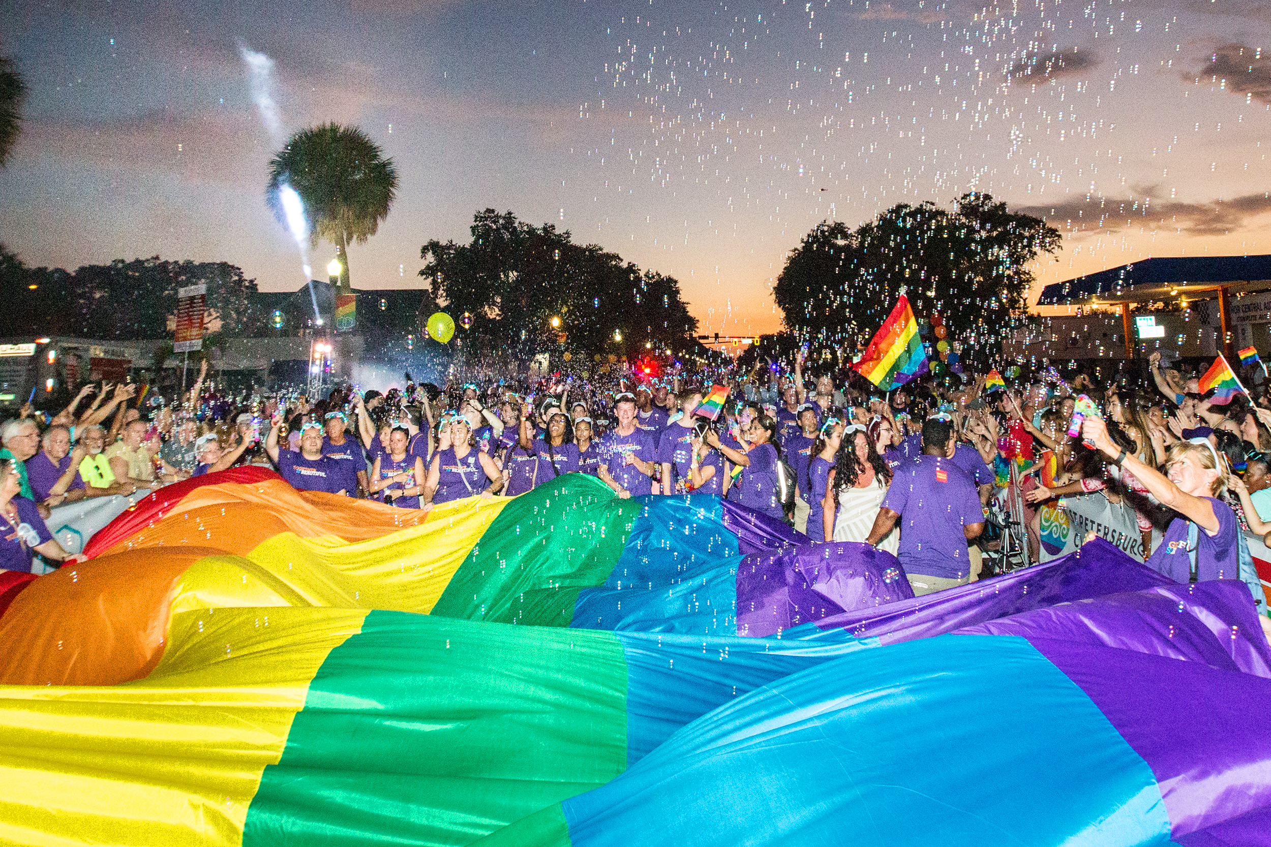 As the sun set tha parade got crankin' with the traditional carrying of the rainbow flag.jpg