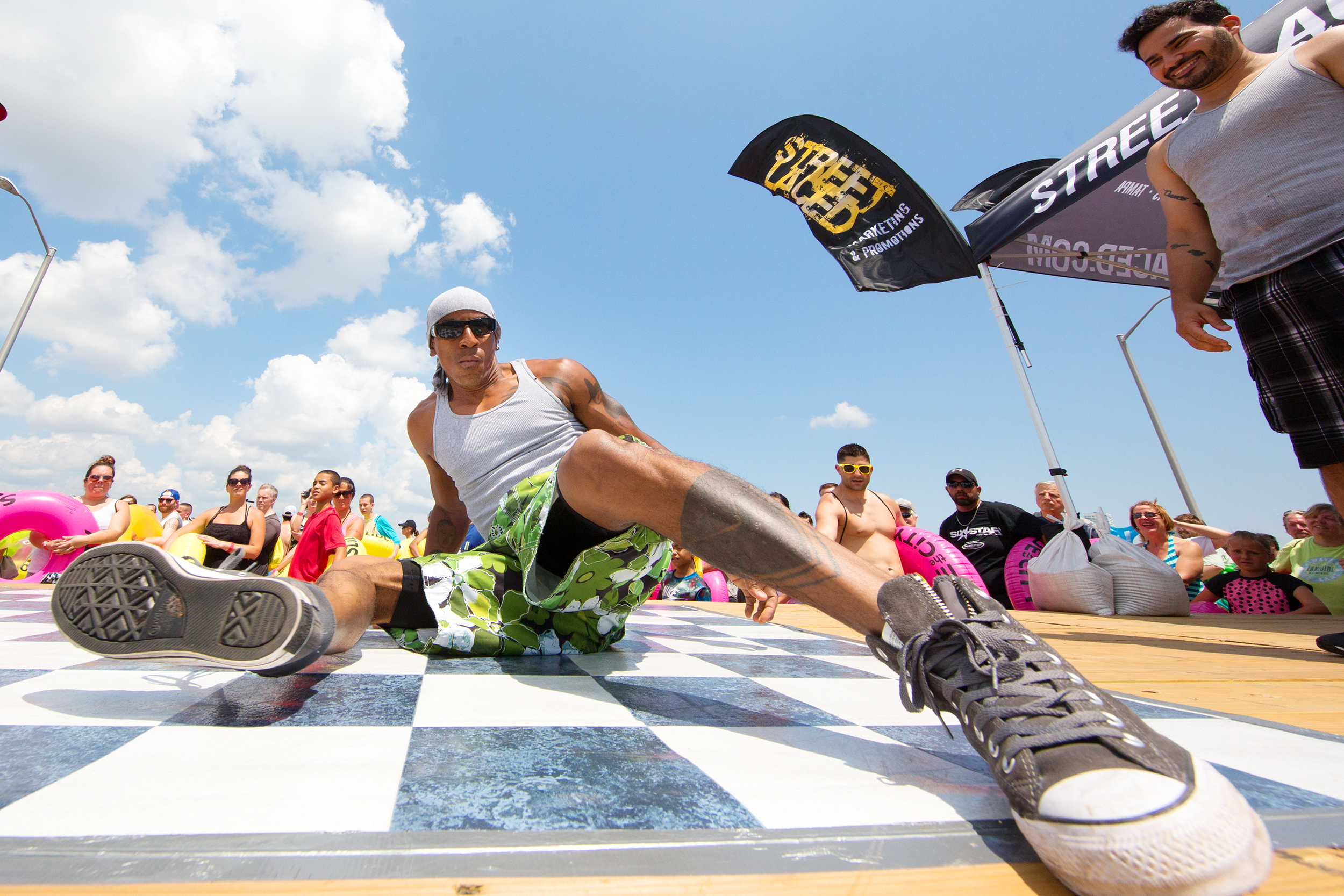 Dancer  Dolo  of Zulu nation breaks a move on the bridge entertaining those waiting to slide 1.jpg