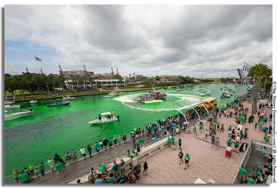 Tampa Fire and Rescue boat Patriot helps blend the green dye into the Hillsborough River for the Mayor's River O'Green 2019