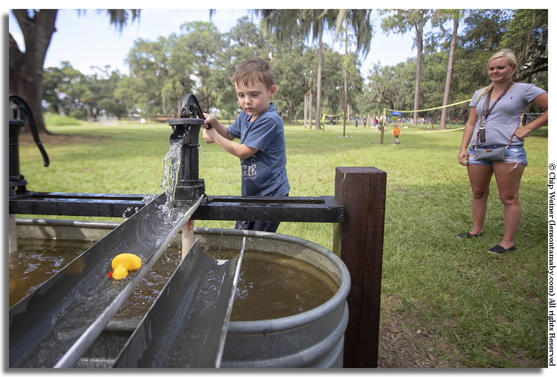 5-year-old Jackson of Plant City makes his own rubber duck race using an old time pump. It's just plain simple fun.