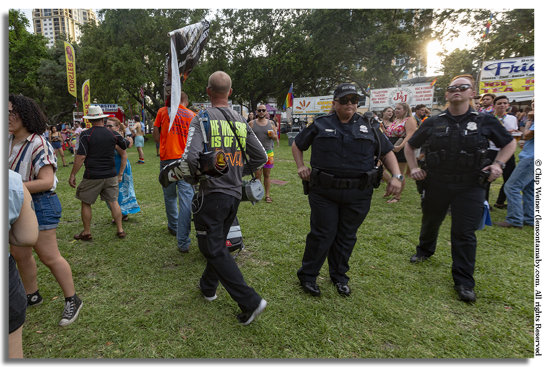 Soon after the ruckus, two sign carriers leave the park