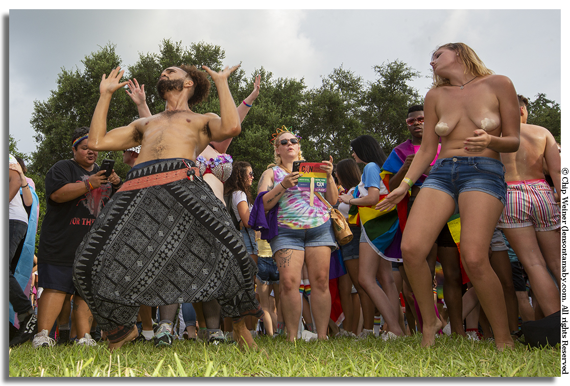 Festival goers dance to the beat of DJ L Mo in sweltering heat at Straub Park during the 2018 St Pete Pride Fest
