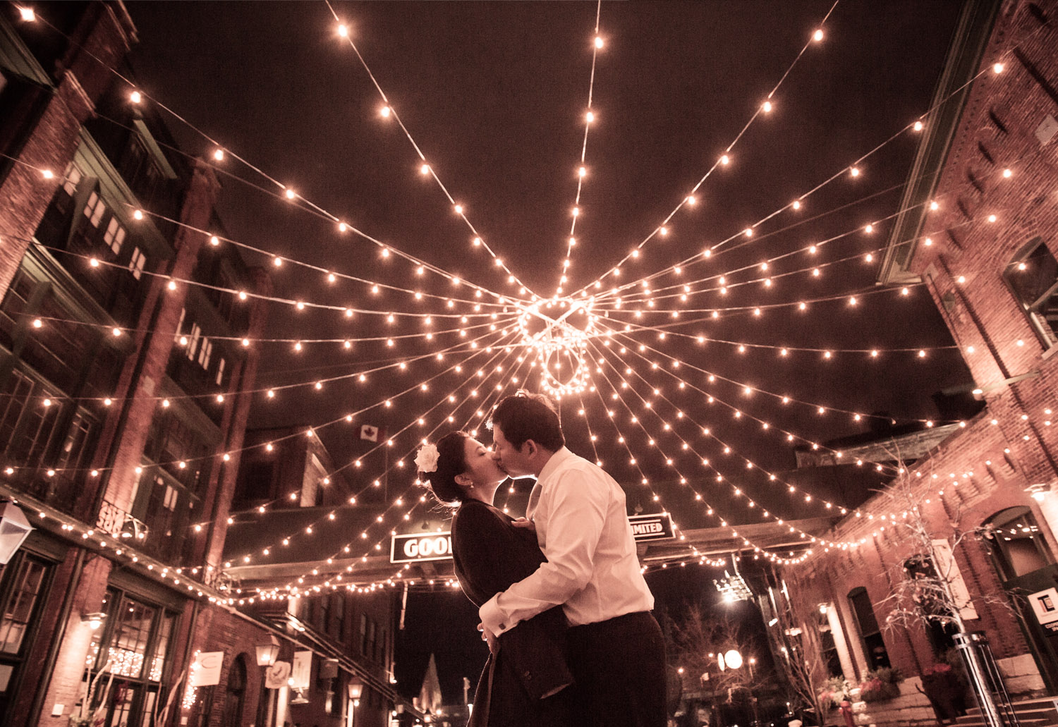 CONGRATULATIONS James & Hyuna  A dreary cold winter day turned into an eclectic, engaging series of images that will be hard to top. January in Toronto's historic Distillery District was the photographic backdrop and playground for me, James, Hyuna and their closest friends. The cloudy day turned to cold night, but at no point could the wet and wonderful Canadian weather dampen our spirits. James and Hyuna you are wonderful couple and I had a blast taking your picture. A couple who truly loves each other create the best photographs, their genuine love shines through the image. It's more captivating and true than any artistic merit or photographic skill. Thank you both for choosing me as your photographer it was wonderful to be a witness.  -J.B.