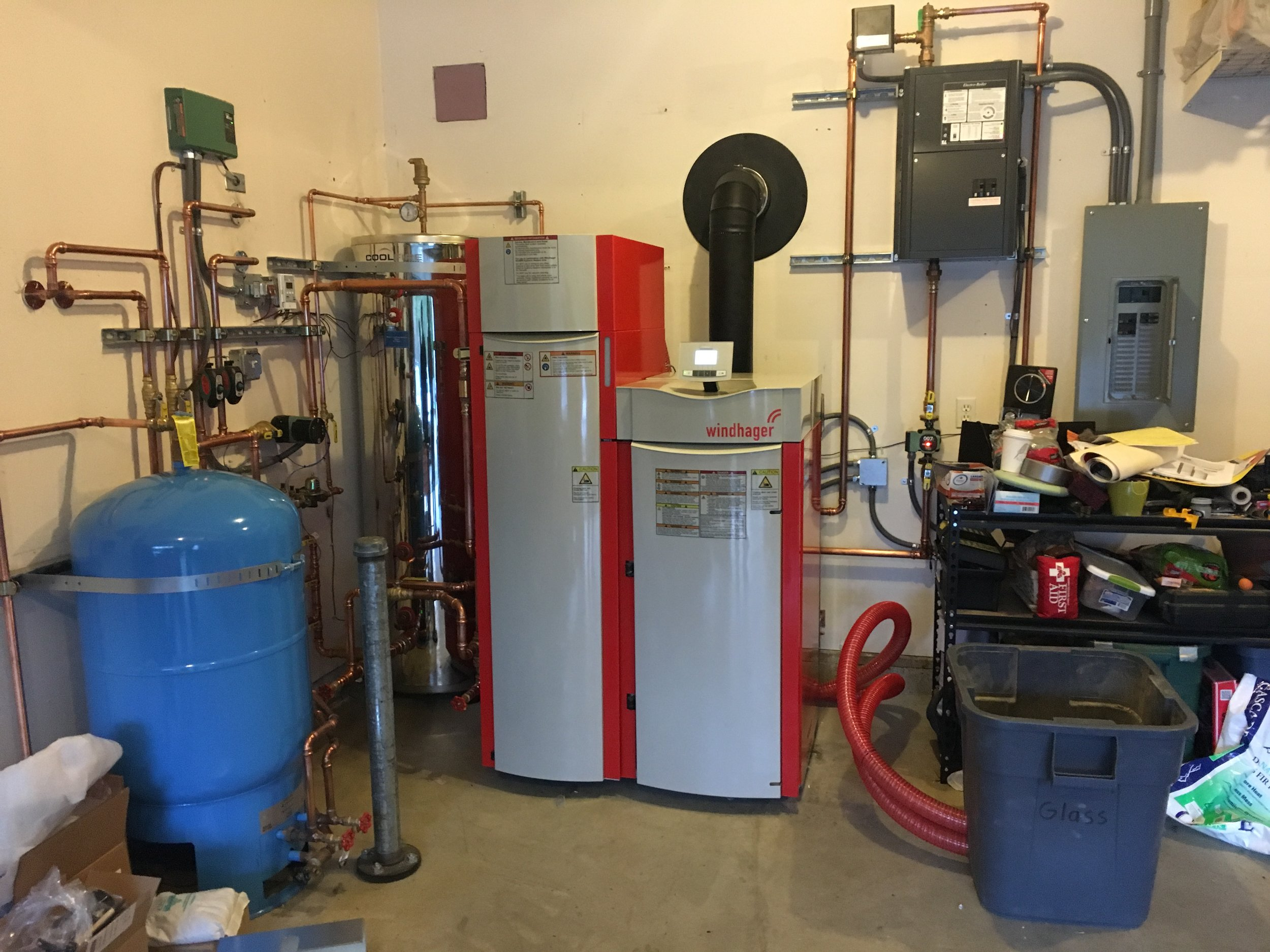 This is the newest biomass boiler in Juneau, Alaska - a small (50,000 btu/hr) Windhager pellet boiler heating a family home. Wisewood Energy procured the boiler and assisted with design and commissioning.