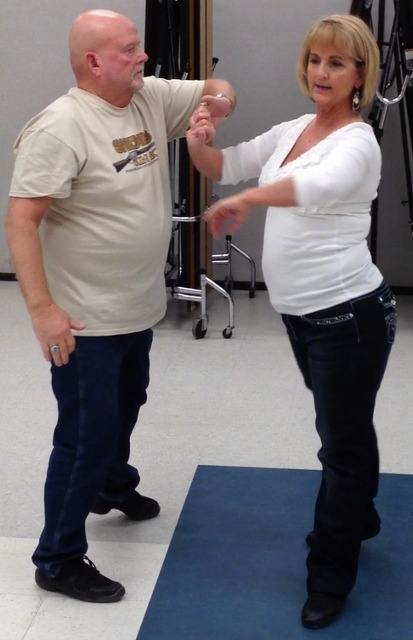 J & A Position in to under arm to change hands (413x640).jpg