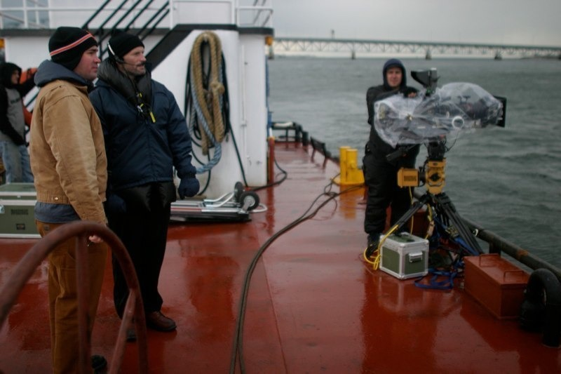 Me and Matthew Barney on a barge in Jamaica Bay shooting plates for Drawing Restraint 9.