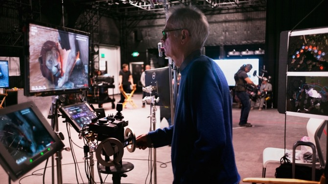 Real-world cinema tools were used to drive the behavior of their VR counterparts. Here Deschanel lines up the camera with a gearhead thus moving the camera in VR.