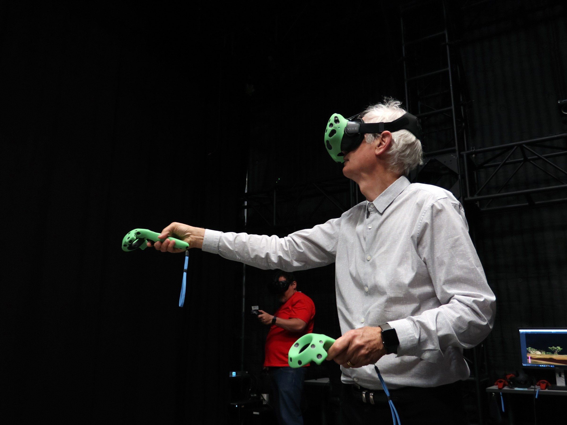 Deschanel lines up a shot in VR.