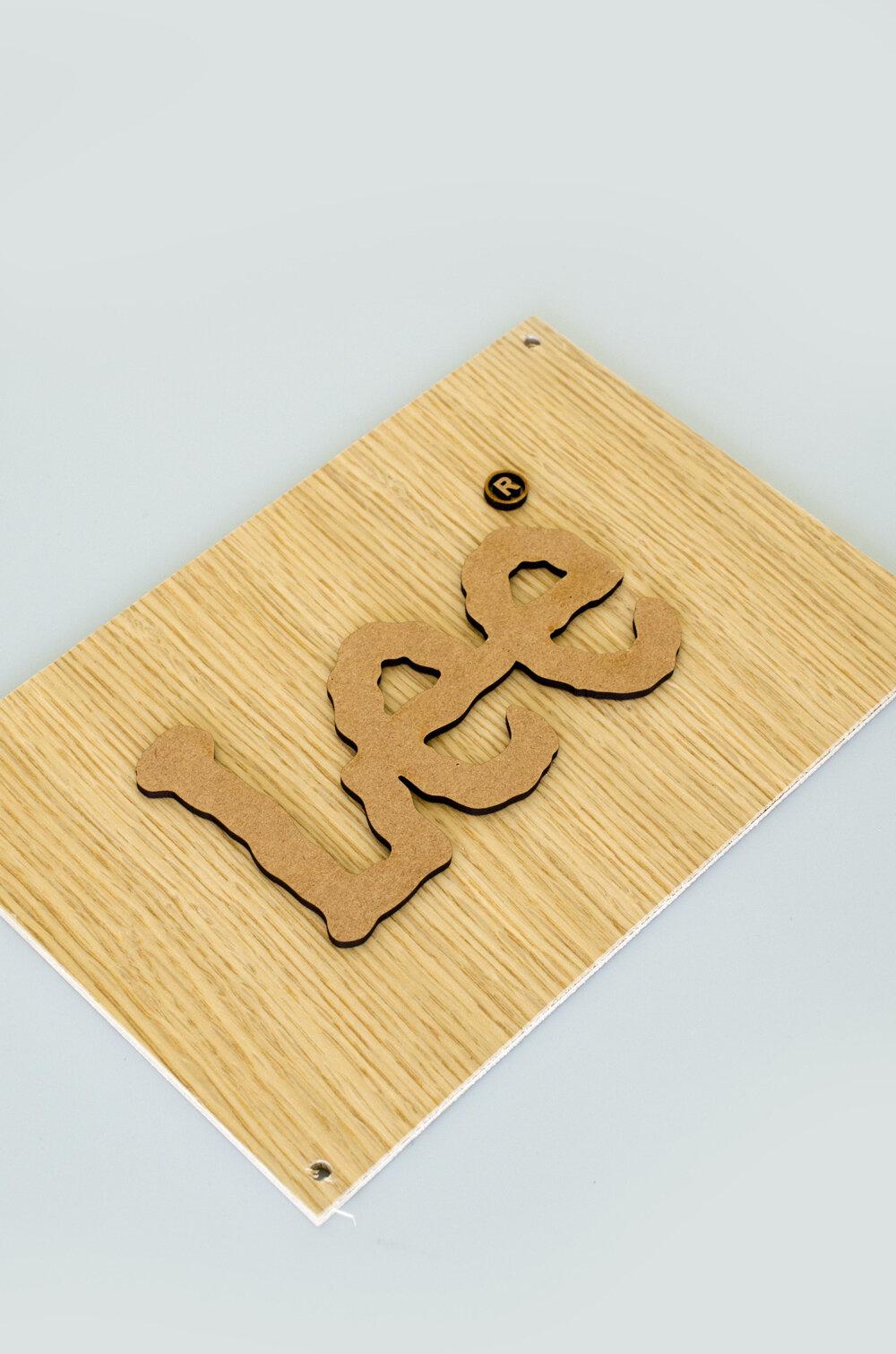Logo en bois découpé au laser