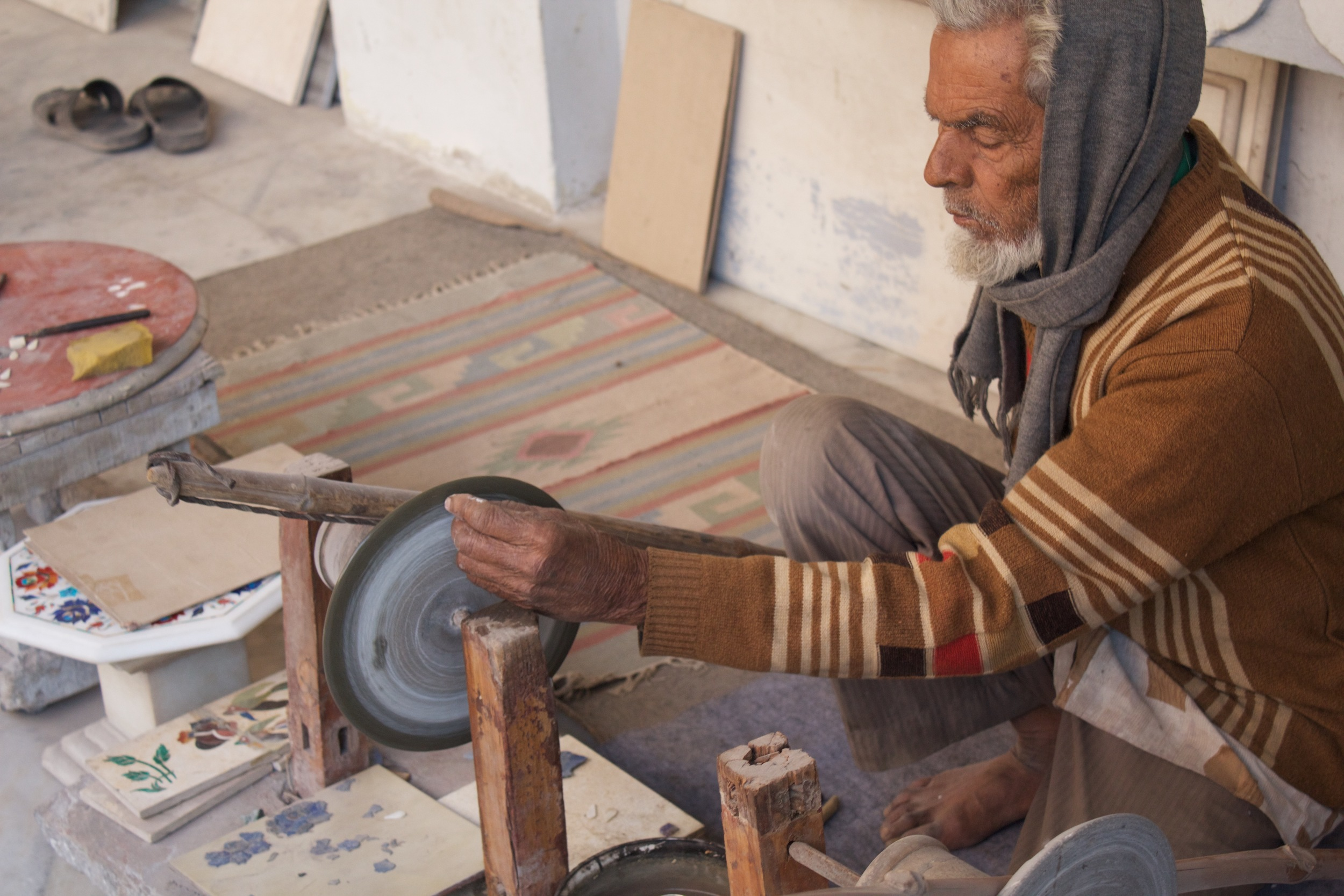 the stone shop out tour guide took us to shop at and where they showed us how they inlaid the stones....
