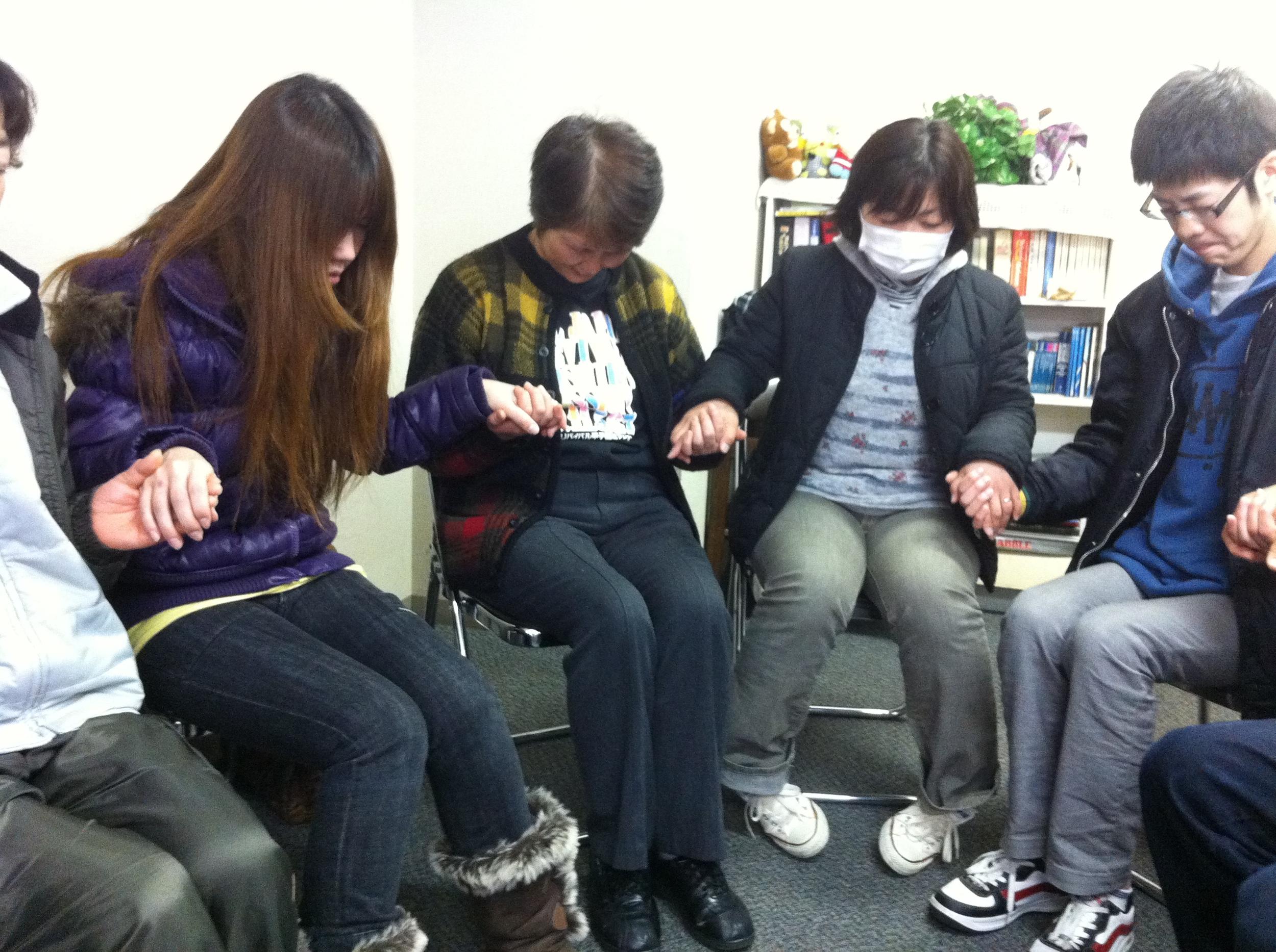 D8 Fukushima Evacs Praying.JPG
