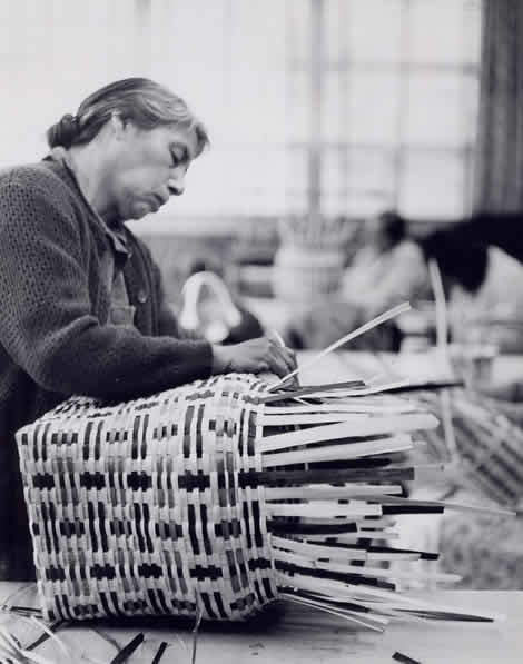 amanda smoker weaves a basket of white oak dyed with native plants. national archives and records administration photograph ~
